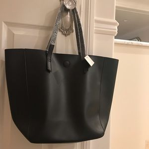 Macy's black tote with cobalt blue inside